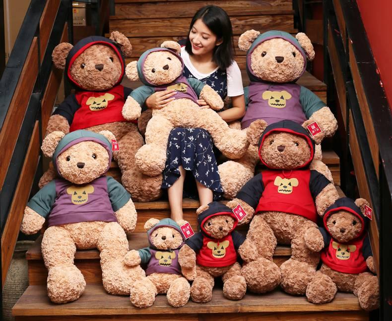 称斤地摊娃娃按斤称布娃娃市场娃娃机玩具婚庆积木公仔毛绒卖毛绒的广告词图片