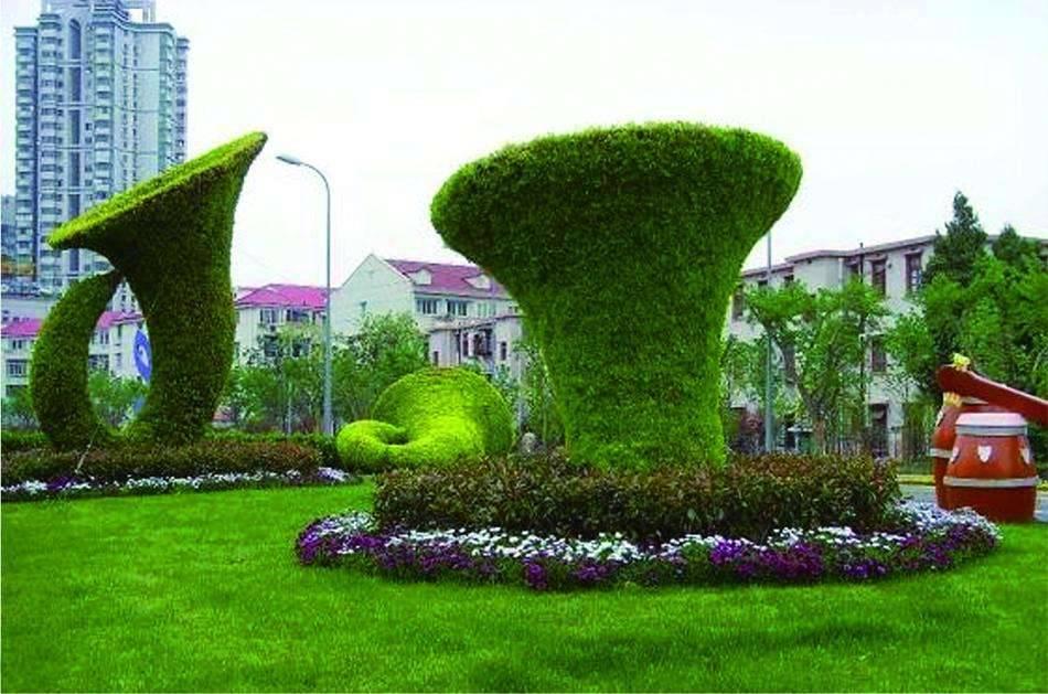 四川內江綠雕景觀花柱花墻造型植物綠雕造型批發