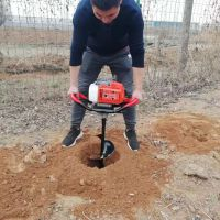 华晨埋桩立式打洞机/8马力汽油挖坑机/篱笆围栏埋桩钻坑机