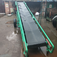 尿素化肥传送输送机 移动式沙石皮带输送机 挡边式土渣输送机