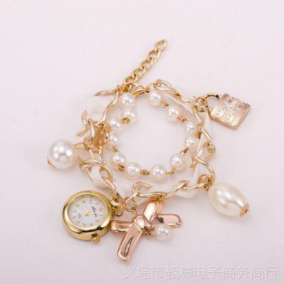 2015新款珍珠手链手表 时尚韩版女士手表 情侣锁领结吊坠现货批