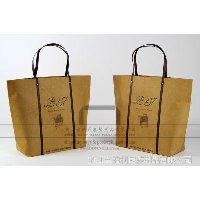 铆钉排绳纸袋定做,生产个性服装袋,中国银行礼品袋,供应牛卡纸手提袋