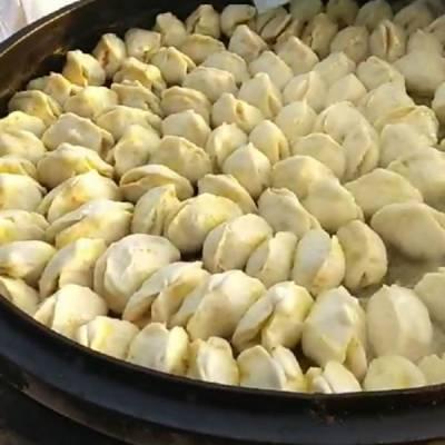 虞城万通机械厂家(图)-燃气水煎包锅价格-商丘水煎包锅价格