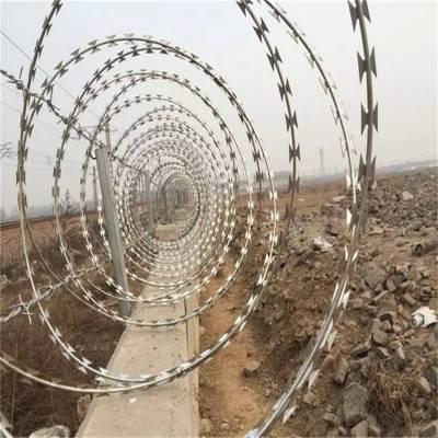 监狱看守所用防爬刀片刺网 圆圈防爬网 围墙顶部防爬刺丝滚笼